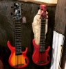 A Cherryburst and Red 5-String uBass in the Kala booth at the NAMM Show.